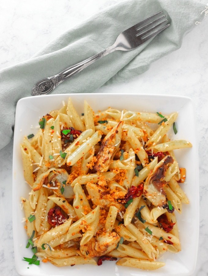 Penne with Crispy Artichoke Hearts with Garlicky Breadcrumbs isn't your regular meatless Monday dinner. With parmigiano reggiano, fresh garlic, herbs, sundried tomatoes and more, no one will complain there's not enough flavor.