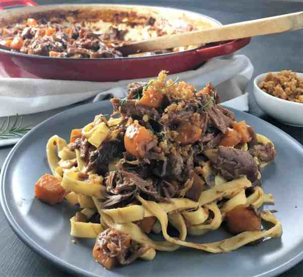 Slow cooked duck pasta - a deliciously easy combination of oven roasted duck simmered on the stove to create a rich flavourful sauce.