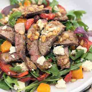 lamb and salad on a white plate