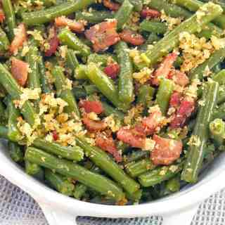 green beans and bacon in a white dish