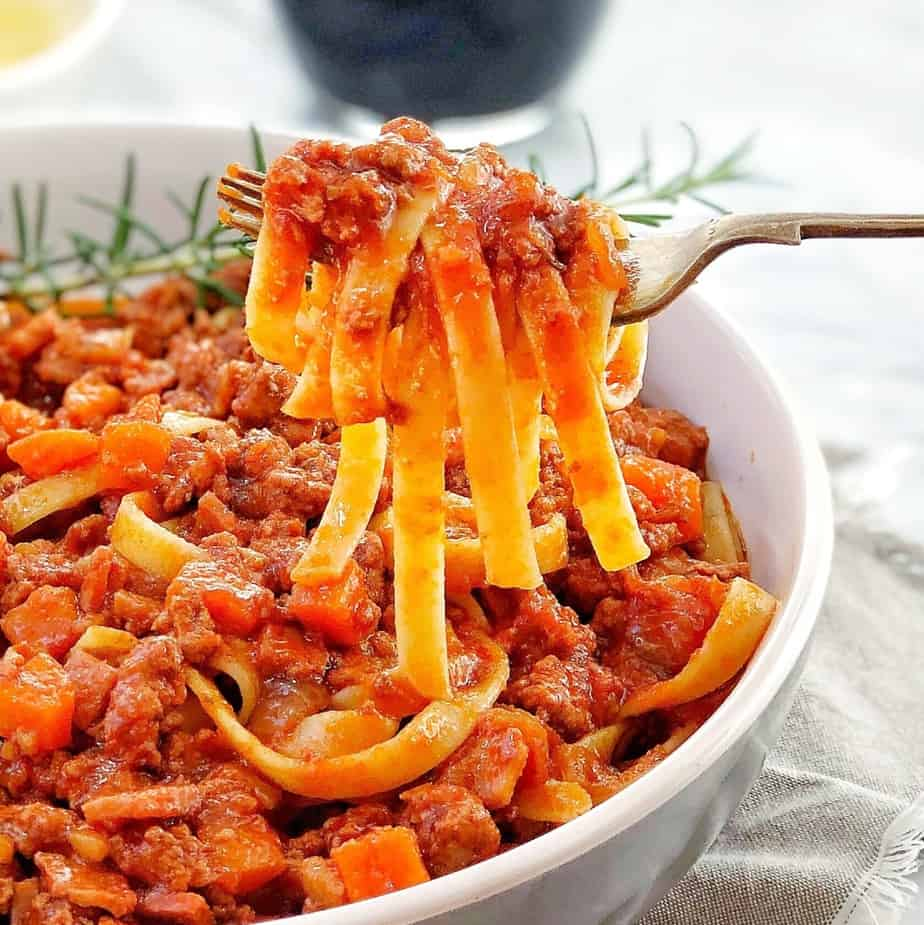 quick lamb ragu with pasta in a white bowl