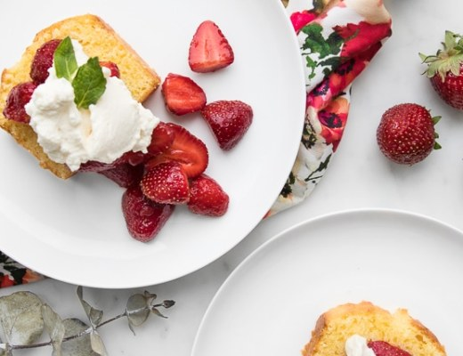 Plate with Slice of Strawberry Shortcake Cake topped with Whipped Mascarpone Cream and Strawberries