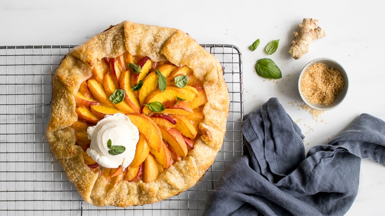 Peach Galette with a scoop of ice cream on a cooling rack