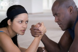 Man and woman arm wrestling, close-up --- Image by © Ocean/Corbis