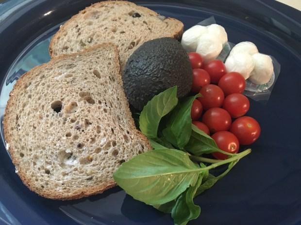 Sprouted grain bread, avocado, grape tomatoes, fresh mozzarella, basil