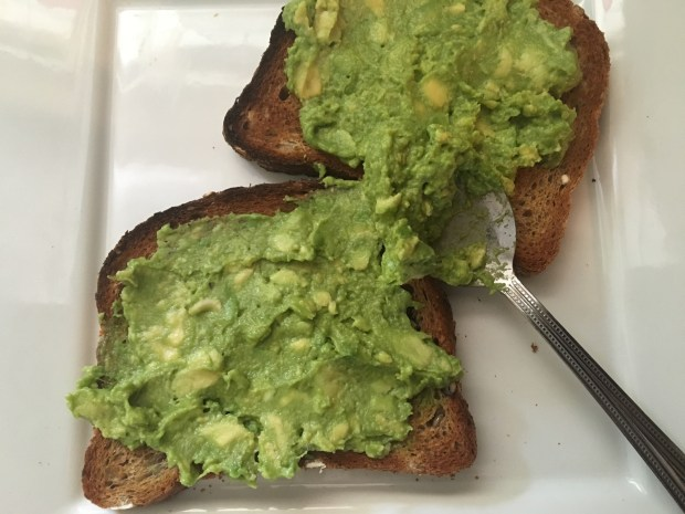 avocado mixture spread onto the toast