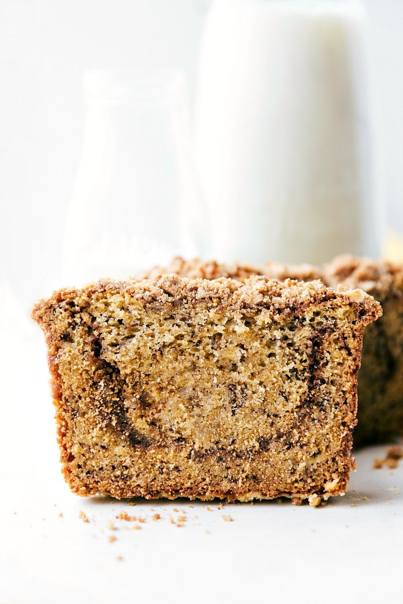 The BEST Banana Bread!! A delicious and easy to make cinnamon-swirled banana bread with a sugared streusel topping. via chelseasmessyapron.com