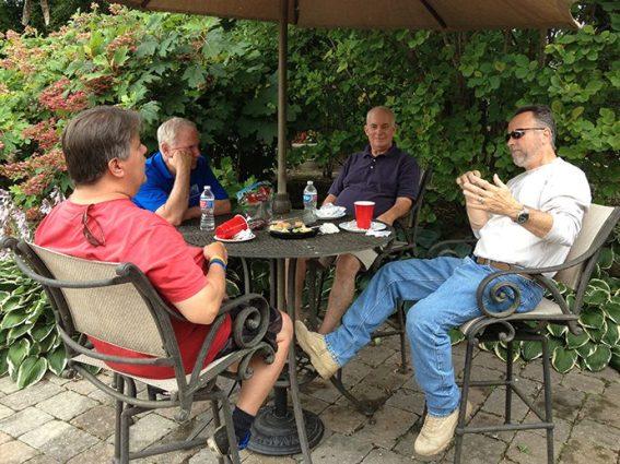 Men talking at table