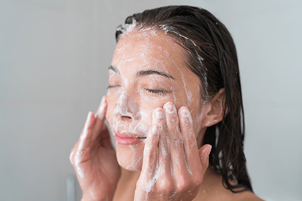 woman using face cleansing products