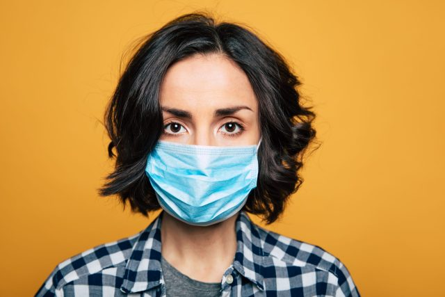 Image Depicting Woman Wearing Disposable Face Mask