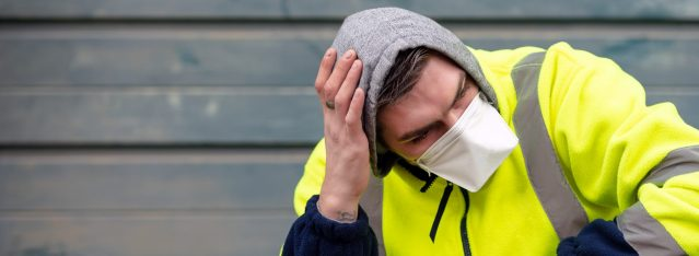 Man Wearing Disposable Safety Mask