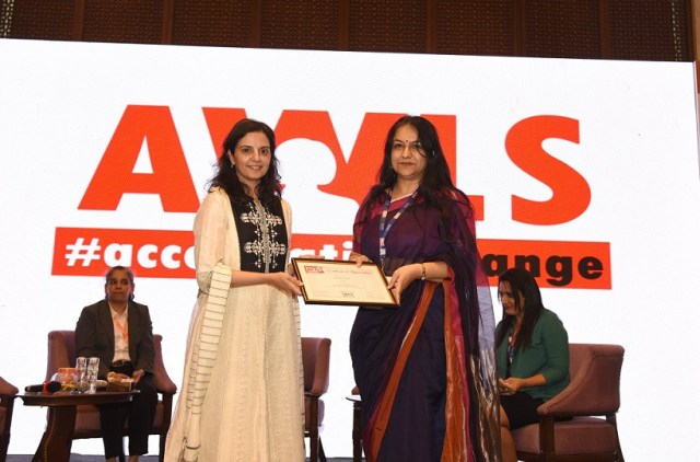 Vandana Chopra receiving the certificate