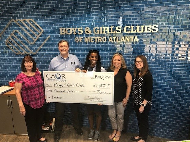 Cherokee Association of REALTORS® Partner with the Boys and Girls Club To Sponsor Their End Of School Year Party