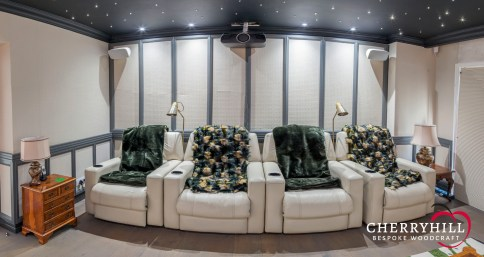 The cinema room in this private Sandhurst residence received a unique treatment with this sound dampening wall panelling and a bespoke screen and speaker cabinet.