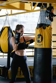 """Power dynamics still favor heroes, even when we have """"feisty"""" heroines like this female boxer."""