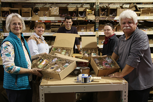 Tom and a few of his packers already packing and shipping for Christmas