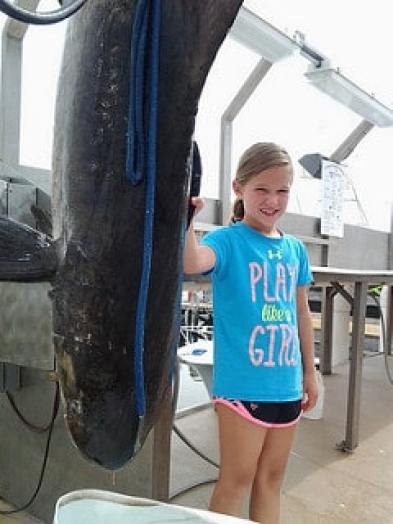 65-pound Emma next to the 94.5-pound cobia she caught on June 30, 2016e