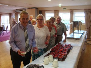 Group-of-members-collecting-their-strawberries-and-cream