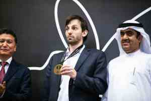 Grischuk picking up his prize