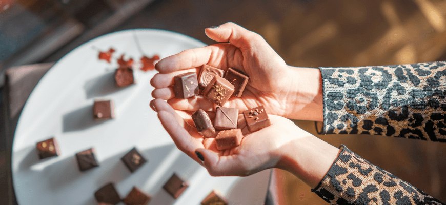 chocolates in hands