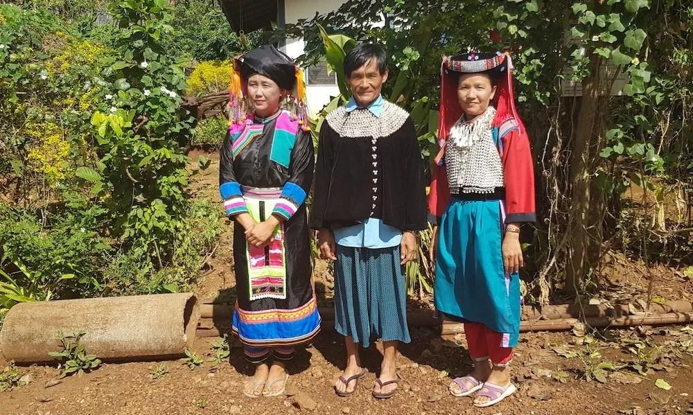 Three people in tribal dress