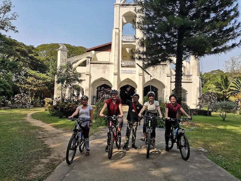 four cyclists in front of Thaw Chapel