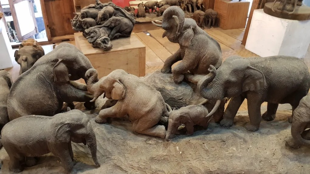 Lots of wooden elephants