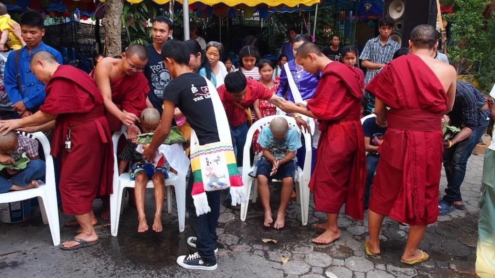 Monks shaving novices
