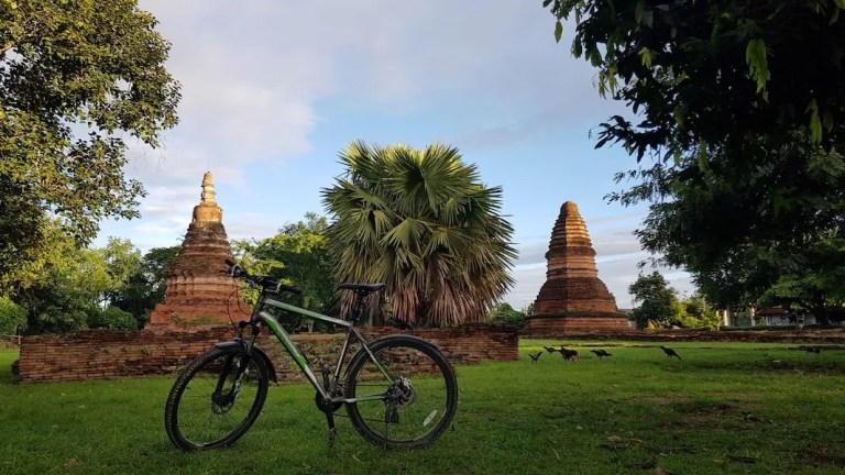 Bicycle with two chedis in the background Wiang Tha Kan