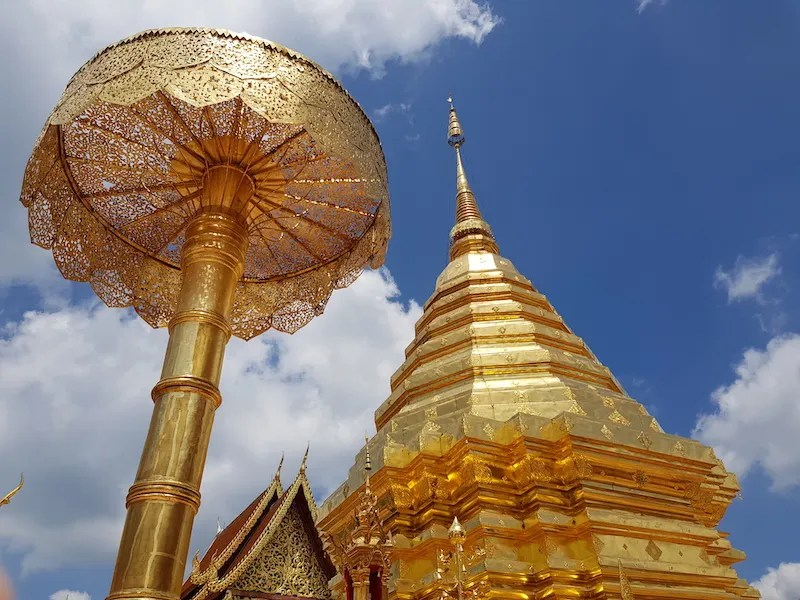 Gold chedi and umbrella