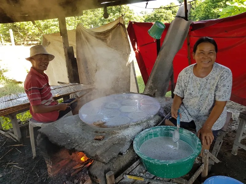 Man and woman making rice cakes