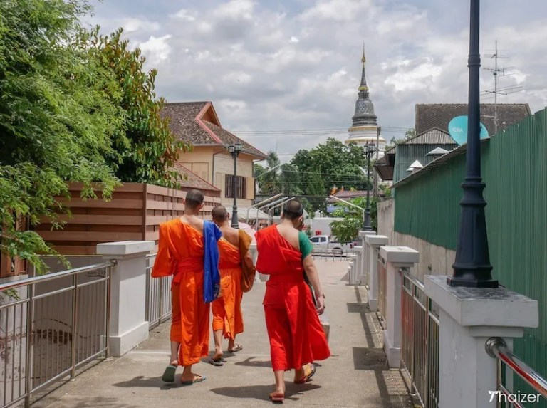 Monks on a foot bridge