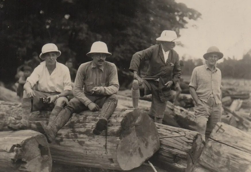 Four man with tree trunks