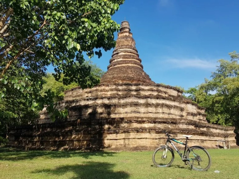 bicycle in front of ruined temple