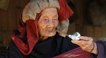 Karen lady smoking tobacco on a porch