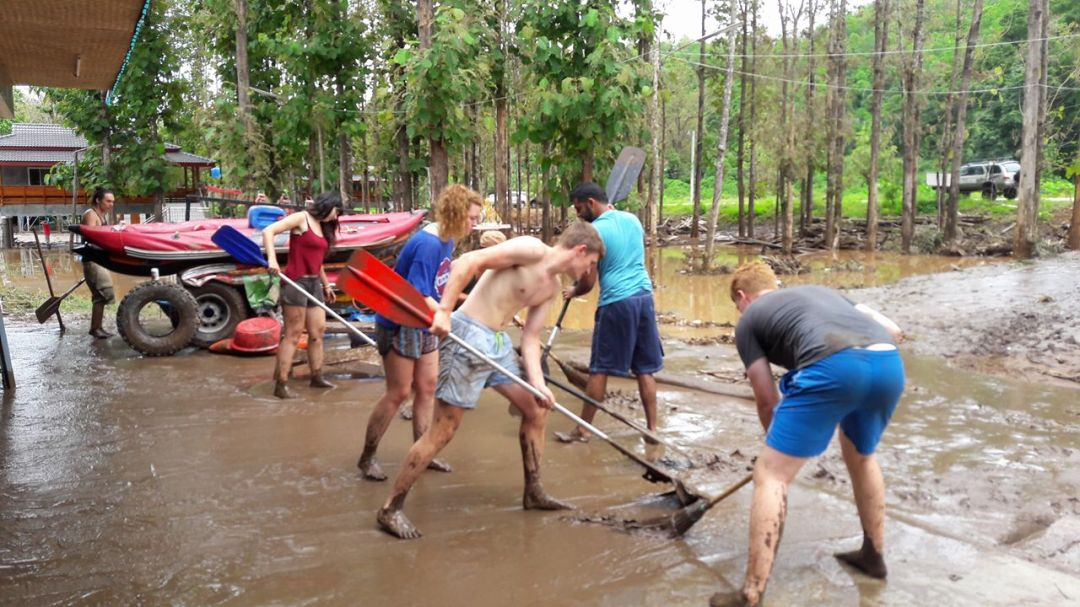Volunteers cleaning after flood in Sop Win