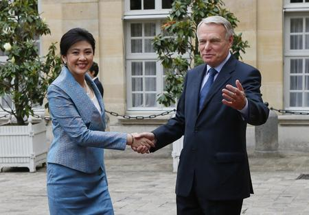 France's Prime Minister Jean-Marc Ayrault welcomes Thailand's Prime Minister Yingluck Shinawatra prior to a lunch on July 20, 2012 in Paris.