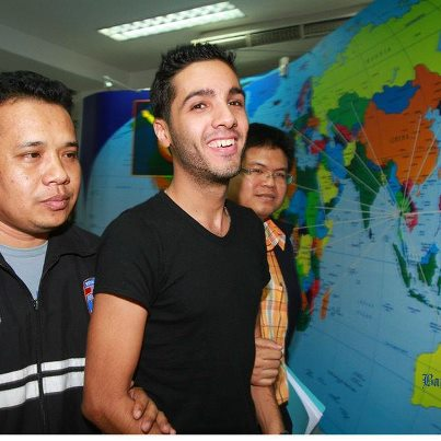 Hamza Bendelladj of Algeria (C), a suspect on the US Federal Bureau of Investigation's top ten wanted list for allegedly hacking private accounts in 217 banks and financial companies worldwide