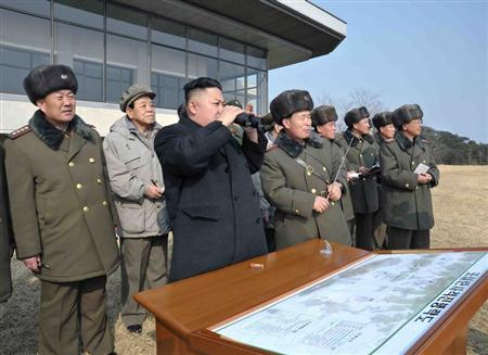 North Korean leader Kim Jong-Un (C) inspects an artillery firing drill of the Korean People's Army units in an undisclosed location in this undated recent