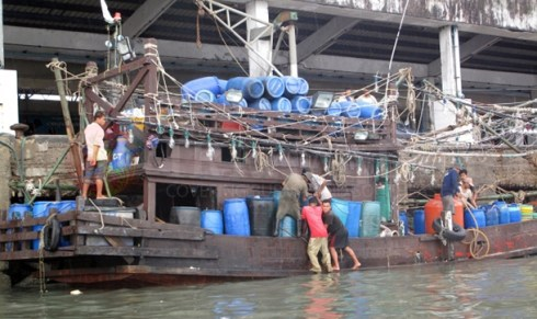 Burmese workers load a fishing vessel in Ranong, southern Thailand.