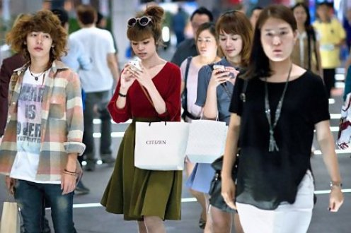 Young middle-class shoppers fill the malls in downtown Bangkok