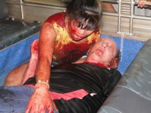 The bloodied couple after today's stabbing at their Patong apartment