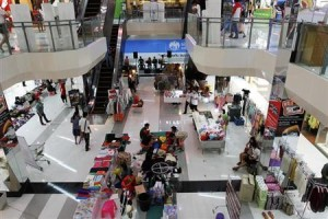 People shop at the Landmark Plaza shopping mall in Udon Thani in northeastern Thailand