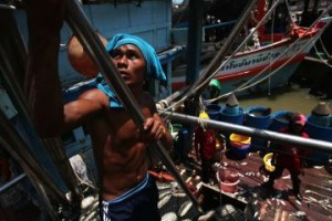 A laborer sorts fish at Pattani port in Thailand's Pattani province
