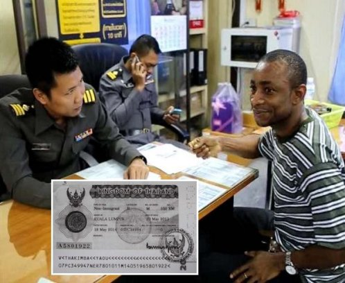 Kimba Yaou, 35, of Niger, was detained by immigration police at Sadao checkpoint in Songkla province Thursday as he was using visa slip No.A5081922 (inset) which was part of the missing visas from the Thai embassy in Kuala Lumpur. (Photo by Wichayant Boonchote)