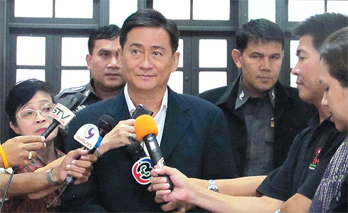 Pol Gen Priewpan Damapong, an advisor to the prime minister talks to reporters
