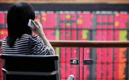 An investor looks at a trading board atThai stock market