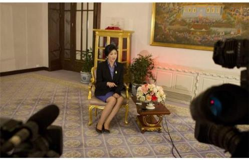 Thai Prime Minister Yingluck Shinawatra speaks during an interview with foreign media at Government House in Bangkok, Thailand Saturday, Dec. 7, 2013. Yingluck said Saturday that while she sees no quick end to her country's deep political impasse, her government is willing to negotiate with opponents to end the crisis. (AP Photo/Sakchai Lalit)