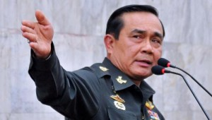 Thai army chief General Prayut Chan-O-Cha gestures as he speaks during a press conference at Thai army's headquarter in Bangkok