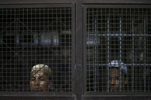 Rohingya Muslim illegal immigrants look out from the Immigration Detention Centre during the Muslim holy fasting month of Ramadan in Kanchanaburi province, in this file picture taken July 10, 2013
